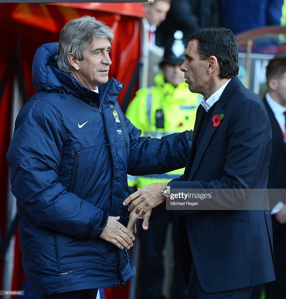Manager Gus Poyet and Manager Manuel Pellegrini shake hands ahead of the Barclays Premier League match between Sunderland and Manchester City at the Stadium of Light on November 10, 2013 in Sunderland, England.