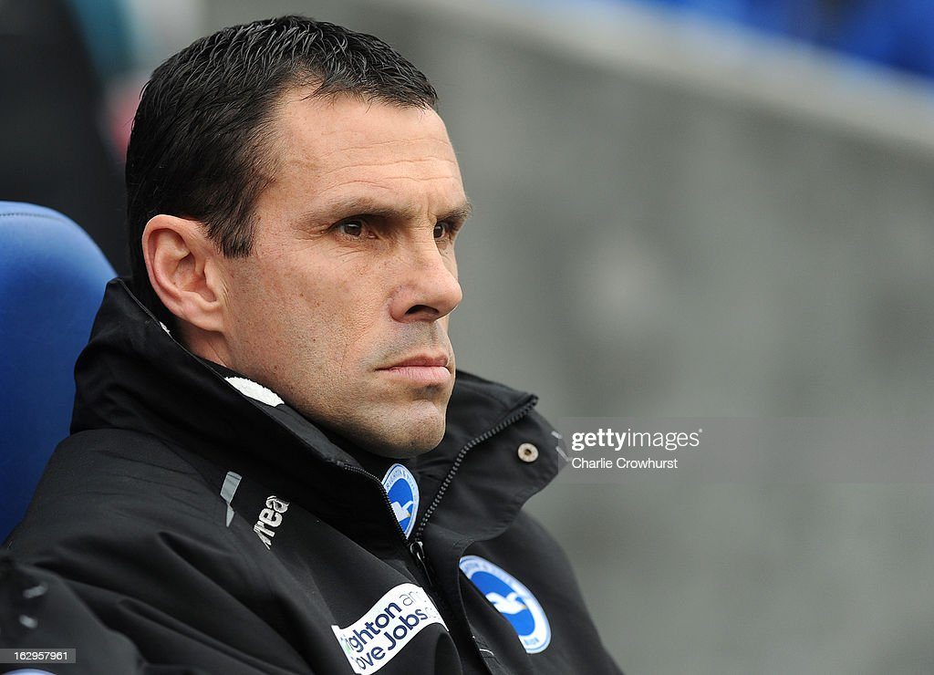 Manager Gus Poyet of Brighton & Hove Albion gets ready for the match during the npower Championship match between Brighton & Hove Albion and Huddersfield Town at The Amex Stadium on March 02, 2013 in Brighton England.