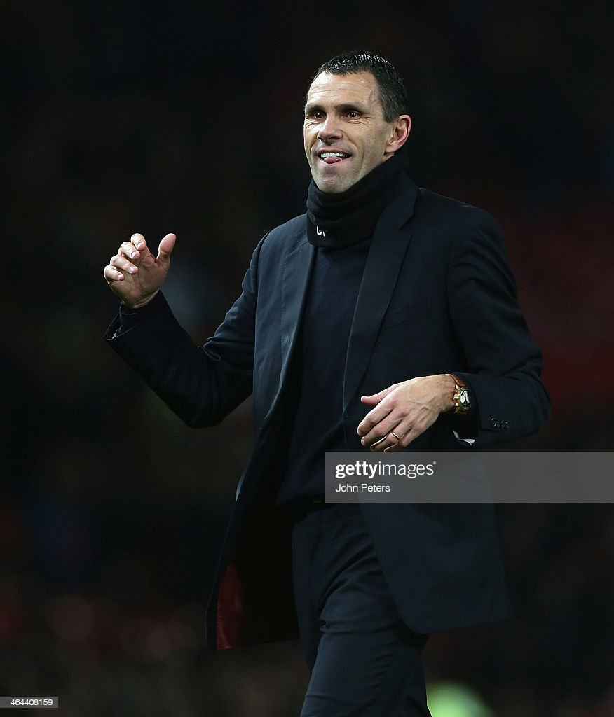 Manager Gus Poyet of Sunderland celebrates at the end of during the Capital One Cup semi-final second leg at Old Trafford on January 22, 2014 in Manchester, England.