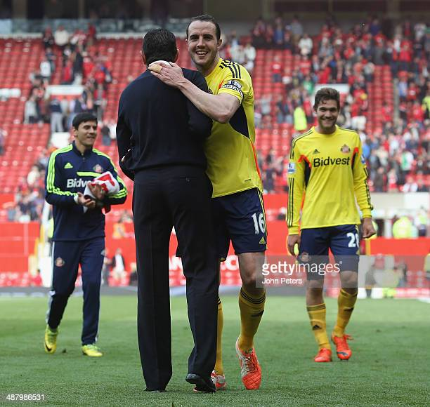 Manager Gus Poyet of Sunderland celebrates with John O'Shea after the Barclays Premier League match between Manchester United and Sunderland at Old...