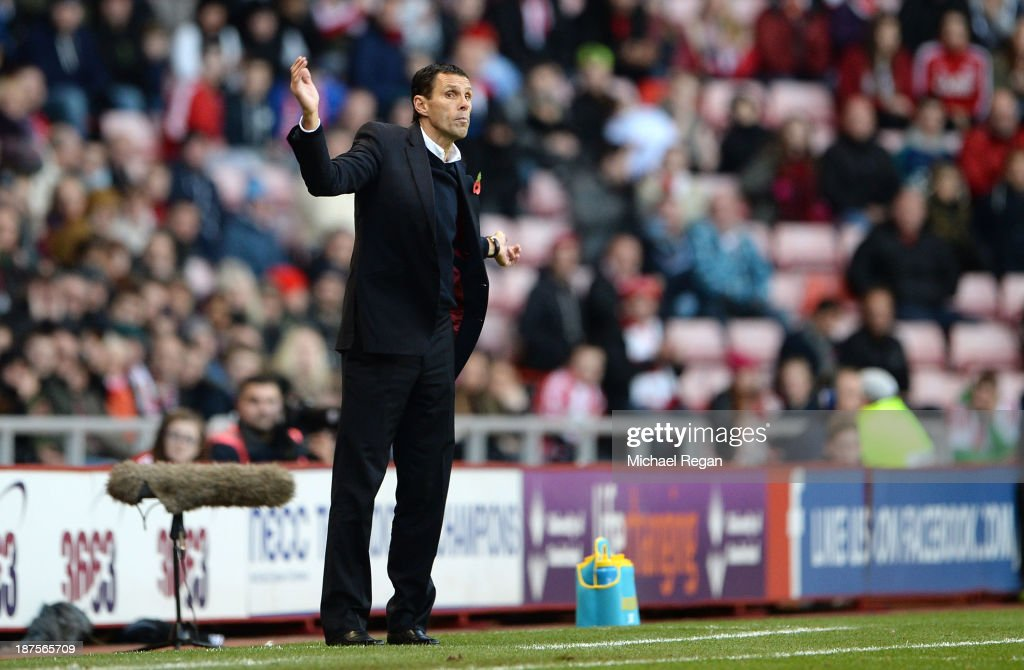 Manager Gus Poyet of Sunderland makes a point during the Barclays Premier League match between Sunderland and Manchester City at the Stadium of Light on November 10, 2013 in Sunderland, England.