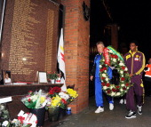Manager Guus Hiddink of Anzhi Makhachkala and captain Samuel Eto'o lay a wreath in memory of the victims of the Hillsborough disaster at the...