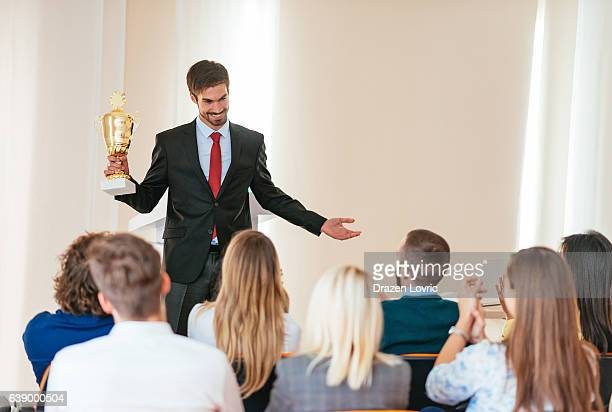 Manager handing award to representative of employees
