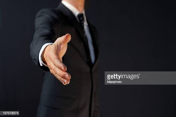 Manager handshake: business man giving hand