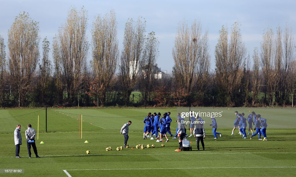 Manager <a gi-track='captionPersonalityLinkClicked' href=/galleries/search?phrase=Harry+Redknapp&family=editorial&specificpeople=204768 ng-click='$event.stopPropagation()'>Harry Redknapp</a> (l) attends a Queens Park Rangers training session at Harlington Sports Centre on November 30, 2012 in Harlington, England.