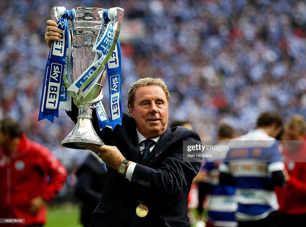 QPR manager <a gi-track='captionPersonalityLinkClicked' href=/galleries/search?phrase=Harry+Redknapp&family=editorial&specificpeople=204768 ng-click='$event.stopPropagation()'>Harry Redknapp</a> celebrates with the trophy after the Sky Bet Championship Playoff Final match between Derby County and Queens Park Rangers at Wembley Stadium on May 24, 2014 in London, England.