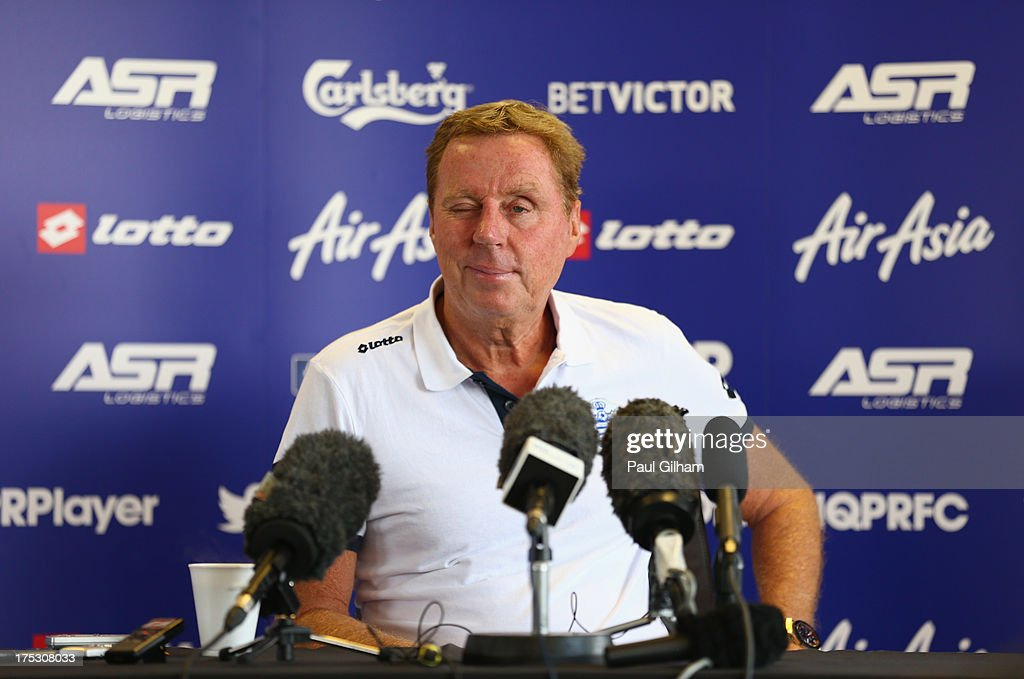 Manager <a gi-track='captionPersonalityLinkClicked' href=/galleries/search?phrase=Harry+Redknapp&family=editorial&specificpeople=204768 ng-click='$event.stopPropagation()'>Harry Redknapp</a> of Queens Park Rangers winks at the media during a Queens Park Rangers training session on August 02, 2013 in Harlington, England.