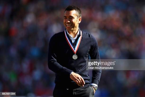 Manager / Head Coach Giovanni van Bronckhorst celebrates in front of the home fans after winning the Dutch Eredivisie at De Kuip or Stadion...