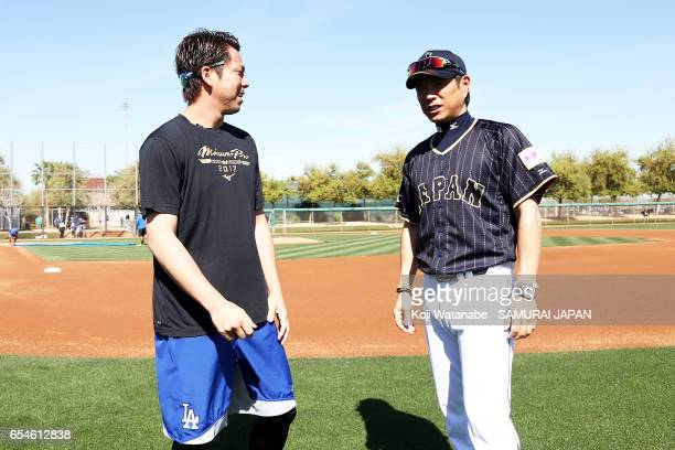 Manager Hiroki Kokubo of Japan and Kenta Maeda of the Los Angeles Dodgers speak during a workout ahead of the World Baseball Classic Championship...