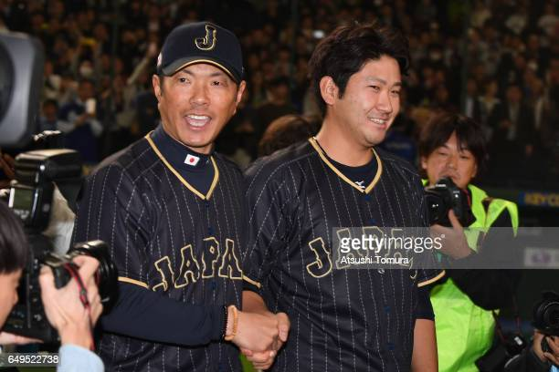 Manager Hiroki Kokubo and Pitcher Tomoyuki Sugano of Japan shake hands after the World Baseball Classic Pool B Game Three between Japan and Australia...