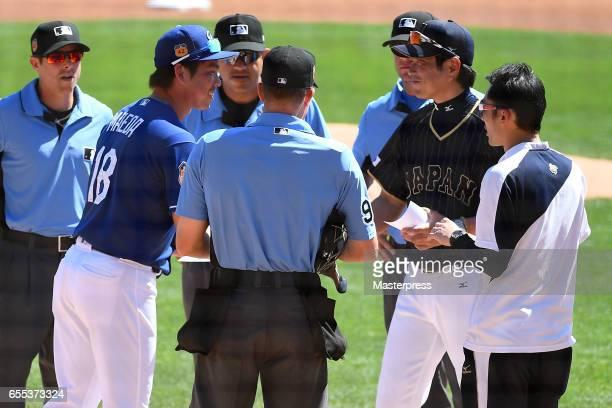 Manager Hiroki Kokubo of Japan and Kenta Maeda of Los Angels Dodgers greet prior to the exhibition game between Japan and Los Angeles Dodgers at...
