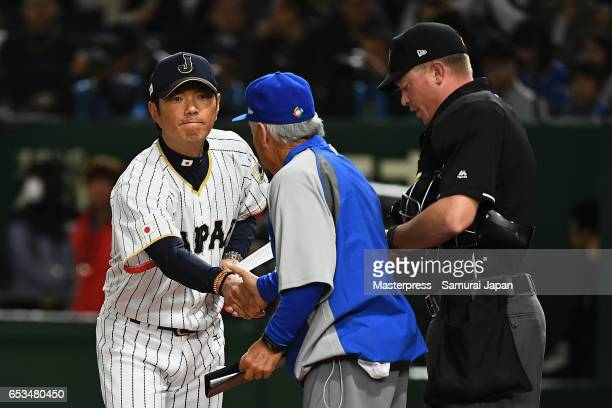 Manager Hiroki Kokubo of Japan and Manager Jerry Weinstein of Israel shake hands prior to the World Baseball Classic Pool E Game Six between Israel...
