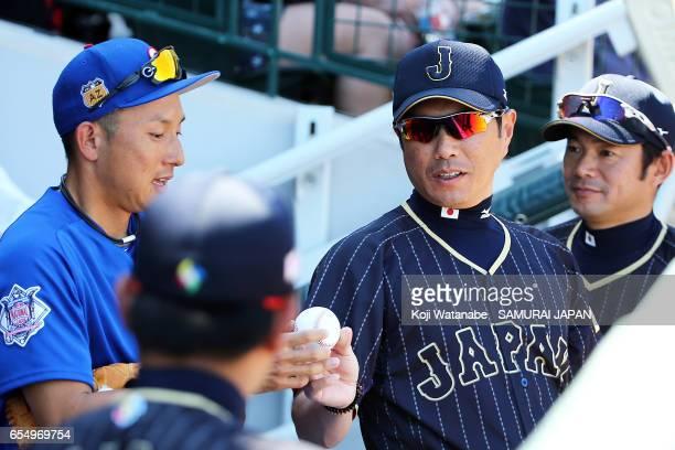 Manager Hiroki Kokubo of Japan and Munenori Kawasaki of Chicago Cubsin speke on during the exhibition game between Japan and Chicago Cubs at Sloan...