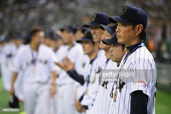 Manager Hiroki Kokubo of Japan and the Japan team line up after winning the WBSC Premier 12 third place play off match between Japan and Mexico at...