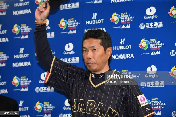 Manager Hiroki Kokubo of Japan applauds fans after his interview after the World Baseball Classic Pool B Game Three between Japan and Australia at...
