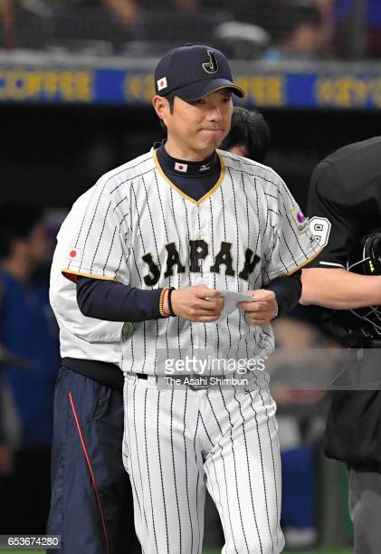 Manager Hiroki Kokubo of Japan calls a pitching change after the bottom of the fifth inning during the World Baseball Classic Pool E Game Six between...