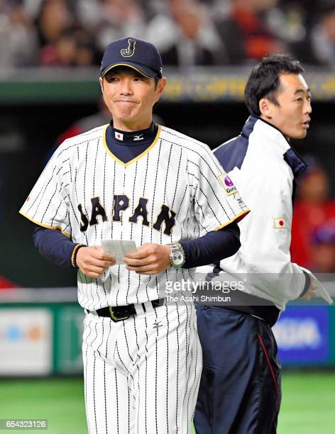 Manager Hiroki Kokubo of Japan calls a pitching change before the top of fifth inning during the World Baseball Classic Pool E Game Four between Cuba...