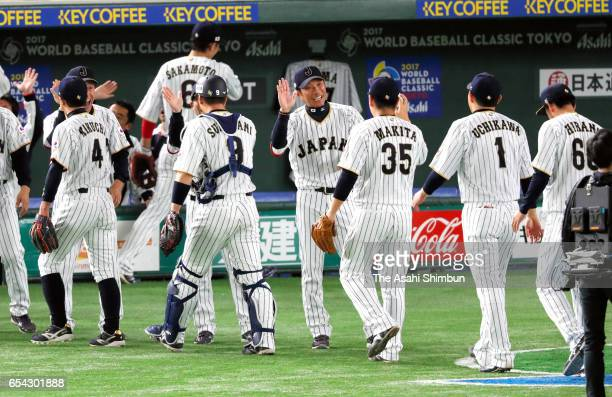 Manager Hiroki Kokubo of Japan high fives with his players after the World Baseball Classic Pool E Game Four between Cuba and Japan at the Tokyo Dome...