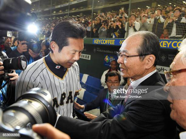 Manager Hiroki Kokubo of Japan is congratulated by former manager Sadaharu Oh after the World Baseball Classic Pool E Game Six between Israel and...