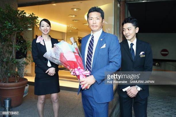 Manager Hiroki Kokubo of Japan poses for photographs as he leaves a hotel for the United States for the World Baseball Classic Championship Round on...
