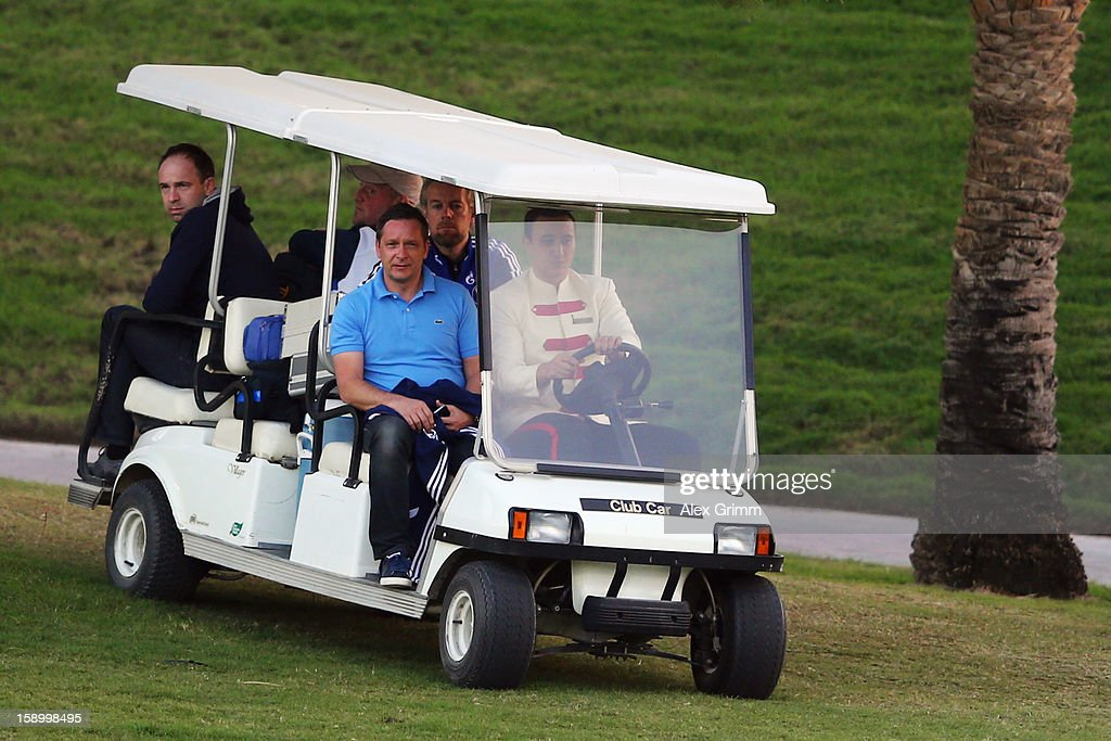 Manager <a gi-track='captionPersonalityLinkClicked' href=/galleries/search?phrase=Horst+Heldt&family=editorial&specificpeople=725318 ng-click='$event.stopPropagation()'>Horst Heldt</a> arrives in a golf cart for a Schalke 04 training session at the ASPIRE Academy for Sports Excellence on January 5, 2013 in Doha, Qatar.