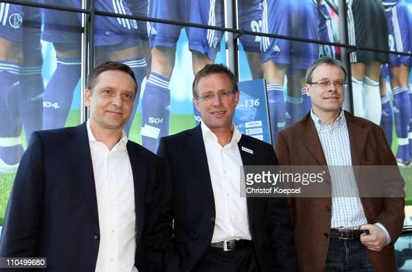 Manager Horst Heldt new head coach Ralf Rangnick and member of the board Peter Peters pose prior to a press conference at the Veltins Arena on March...