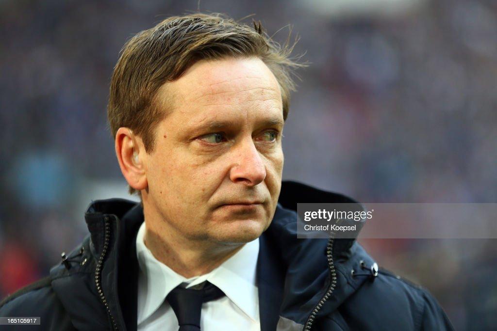 Manager Horst Heldt of Schalke looks dejected during the Bundesliga match between FC Schalke 04 and TSG 1899 Hoffenheim at Veltins-Arena on March 30, 2013 in Gelsenkirchen, Germany.