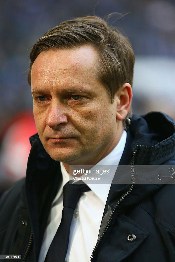 Manager Horst Heldt of Schalke looks on prior to the Bundesliga match between FC Schalke 04 and TSG 1899 Hoffenheim at Veltins-Arena on March 30, 2013 in Gelsenkirchen, Germany.