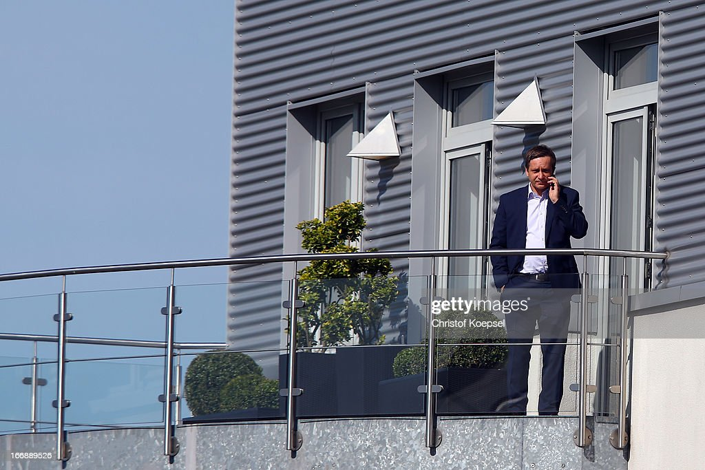 Manager Horst Heldt phones on the balcony during the FC Schalke 04 training session at their training ground on April 18, 2013 in Gelsenkirchen, Germany.