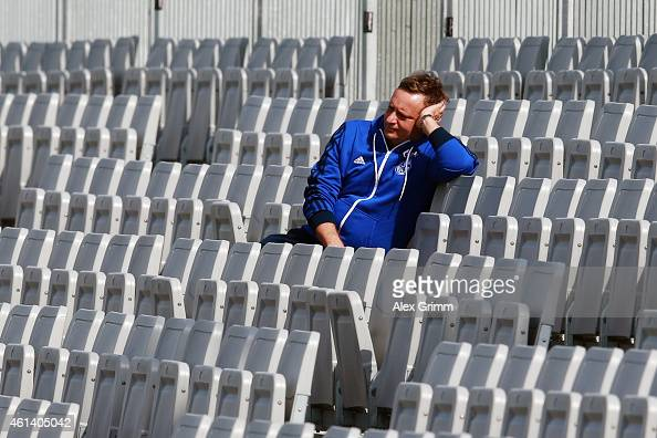 Manager Horst Heldt sits in the stand during day 7 of the FC Schalke 04 training camp at the ASPIRE Academy for Sports Excellence on January 12 2015...
