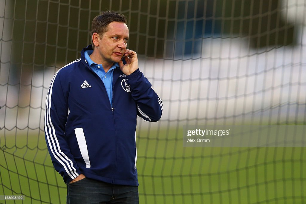 Manager <a gi-track='captionPersonalityLinkClicked' href=/galleries/search?phrase=Horst+Heldt&family=editorial&specificpeople=725318 ng-click='$event.stopPropagation()'>Horst Heldt</a> takes on his mobile during a Schalke 04 training session at the ASPIRE Academy for Sports Excellence on January 5, 2013 in Doha, Qatar.