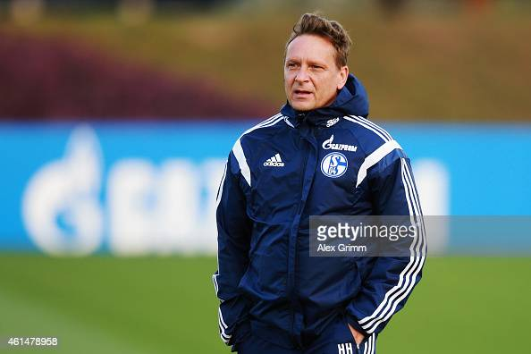 Manager Horst Heldt walks on the pitch during the FC Schalke 04 training camp at ASPIRE Academy for Sports Excellence on January 13 2015 in Doha Qatar