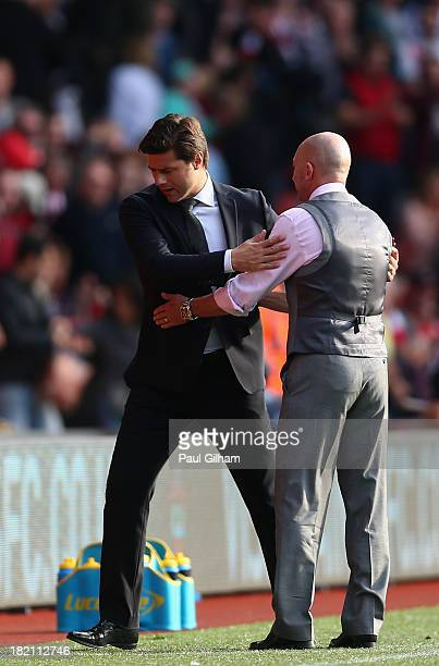 Manager Ian Holloway of Crystal Palace congratulates manager Mauricio Pochettino of Southampton at the end of the Barclays Premier League match...