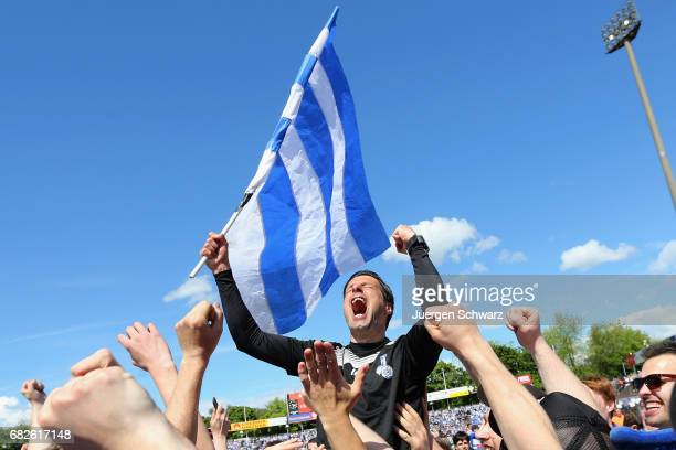 Manager Ilia Gruev of Duisburg celebrates with supporters after winning the match to step up to the second league after the third league match...