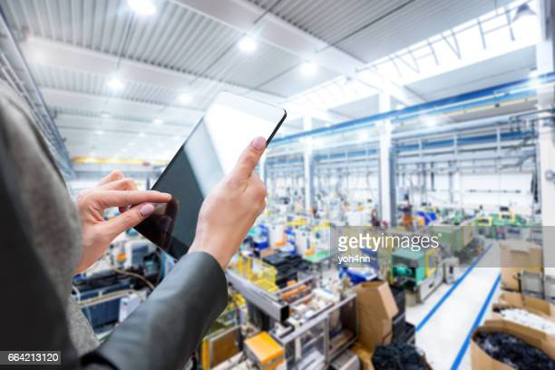 Manager in the factory & digital tablet