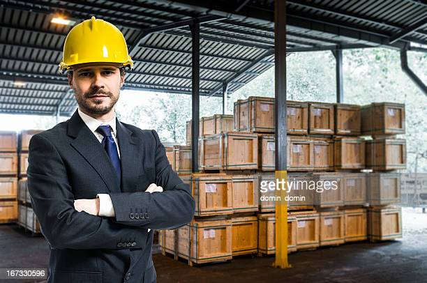 Manager, Inspector, Owner in external industrial warehouse with wooden boxes