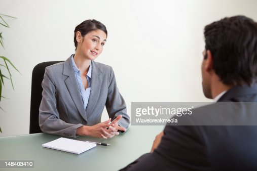 Manager interviewing a good looking applicant : Stock Photo