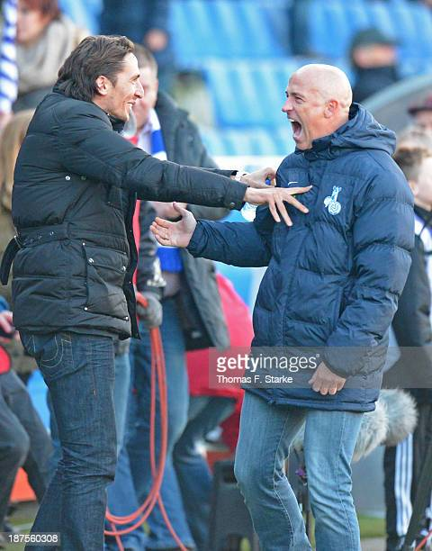 Manager Ivica Grlic and head coach Karsten Baumann of Duisburg celebrate after winning the Third League match between between VfL Osnabrueck and MSV...
