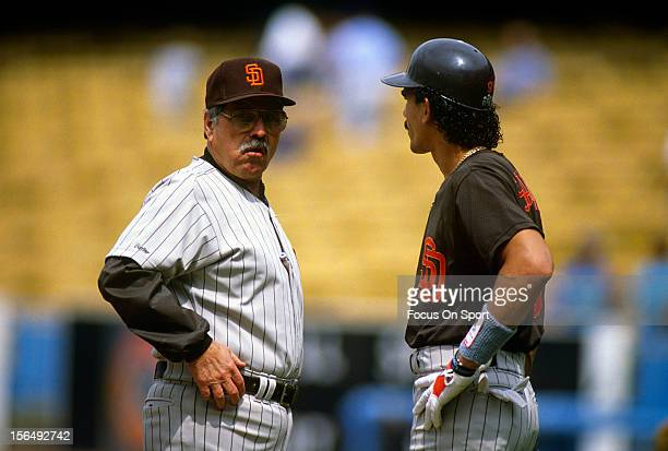 Manager Jack McKeon of the San Diego Padres talks with his player Benito Santiago during an Major League Baseball game circa 1990 McKeon managed the...
