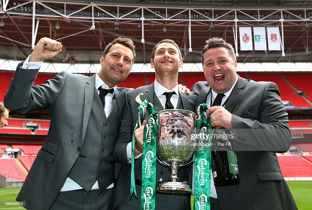 Manager Jason Ainsley, Club Captain Daniel Moore and Assistant Coach Gavin Fell celebrate with the trophy during the FA Carlsberg Vase Final match between Spennymoor Town FC and Tunbridge Wells FC at Wembley Stadium on May 4, 2013 in London, England.