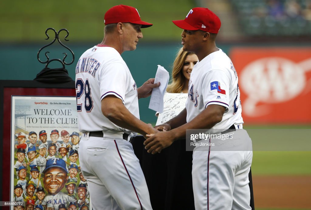 Manager Jeff Banister #28 congratulates Adrian Beltre #29 of the Texas Rangers during a pre-game ceremony celebrating Beltre's 3000th hit before the New York Yankees played the Texas Rangers at Globe Life Park in Arlington on September 8, 2017 in Arlington, Texas.