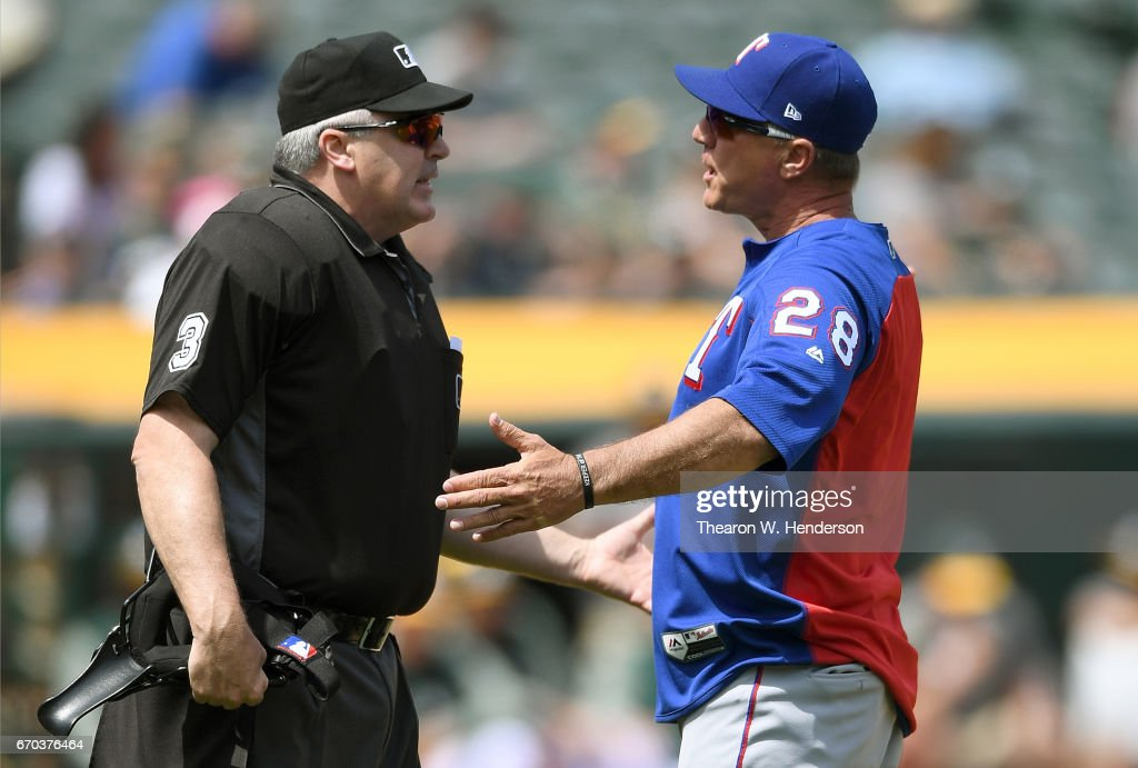 Manager Jeff Banister #28 of the Texas Rangers argues with home plate umpire Bill Welke #3 over a foul ball call during a Major League Baseball game against the Oakland Athletics in the bottom of the third inning at Oakland Alameda Coliseum on April 19, 2017 in Oakland, California.