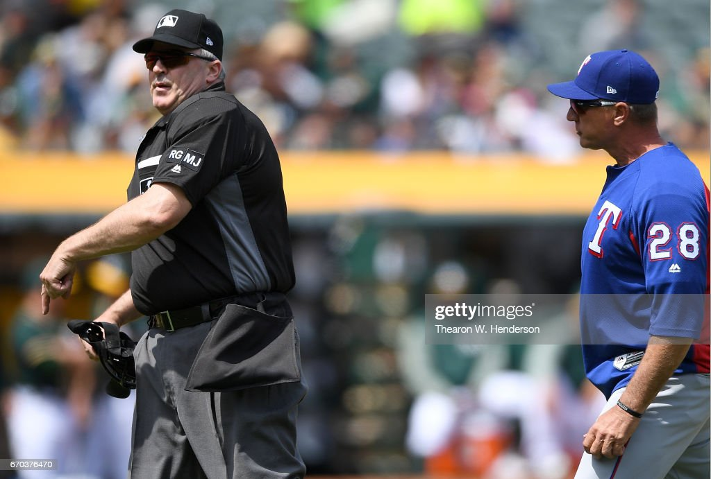 Manager Jeff Banister #28 of the Texas Rangers gets thrown out of the game by home plate umpire Bill Welke #3 over a foul ball call against the Oakland Athletics in the bottom of the third inning at Oakland Alameda Coliseum on April 19, 2017 in Oakland, California.