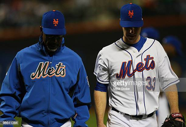 Manager Jerry Manuel of the New York Mets walks John Maine off the field after suffering an injury in the forth inning against the Atlanta Braves on...