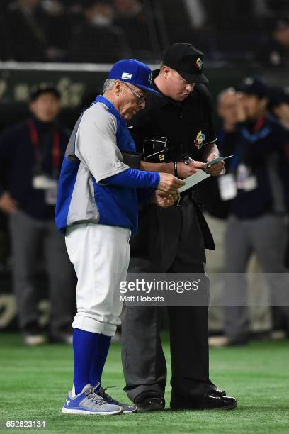 Manager Jerry Weinstein of Israel calls defensive changes at the beginning of the top of the seventh inning during the World Baseball Classic Pool E...