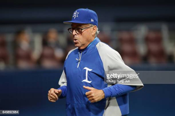 Manager Jerry Weinstein of Israel runs to the dugout after a pitching change in the top of the eighth inning during the World Baseball Classic Pool A...