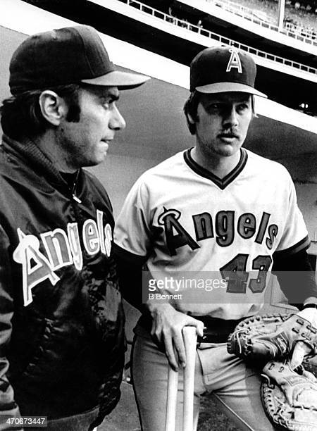 Manager Jim Fregosi of the California Angels talks with newly acquired catcher Dave Skaggs prior to the game against the Cleveland Indians on May 14...