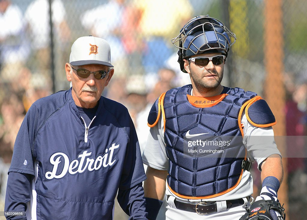 Manager Jim Leyland #10 and Alex Avila #13 of the Detroit Tigers look on during Spring Training workouts at the TigerTown Facility on February 20, 2013 in Lakeland, Florida.