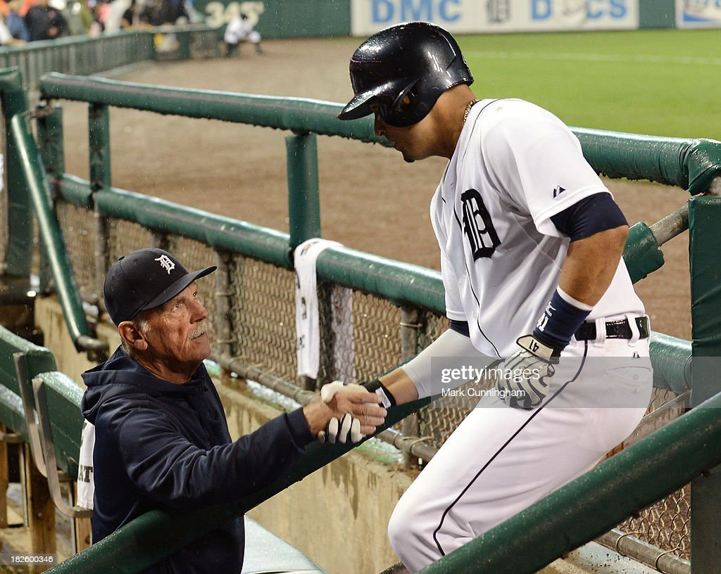 Manager Jim Leyland #10 and Victor Martinez #41 of the Detroit Tigers shake hands in the dugout during the game against the Chicago White Sox at Comerica Park on September 20, 2013 in Detroit, Michigan. The Tigers defeated the White Sox 12-5.