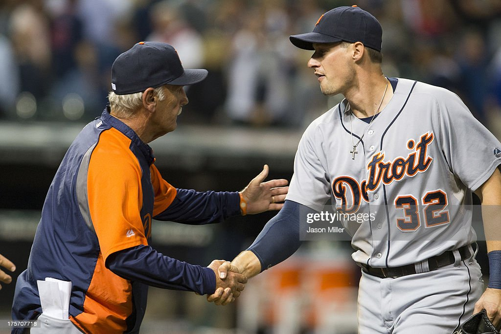 Manager Jim Leyland #10 celebrates with Don Kelly #32 of the Detroit Tigers after the Tigers defeated the Cleveland Indians at Progressive Field on August 6, 2013 in Cleveland, Ohio. The Tigers defeated the Indians 5-1.
